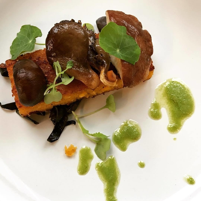Feast of the Blossom Moon First course: Seared Cornbread - Smoked Forest Mushrooms - Spruce Tip Oil - Nasturtium Leaf